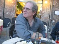 Author Brian Appleton sitting at an outdoor cafe